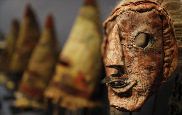 A rare antique tribal mask, Kachina Hapota, circa 1910-1920, revered as a sacred ritual artifact by the Native American Hopi tribe in Arizona is displayed at the Drouot auction house in Paris before auction, December 9, 2013. The Hopi, some of whose 18,000 members continue to follow a traditional way of life farming on three isolated mesas, believe the bright, mostly fabric masks are imbued with the spirits of divine messengers.