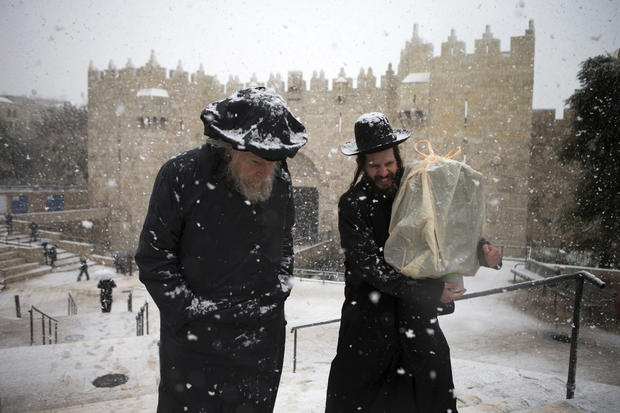 Ultra orthodox jews walk past the Damascus gate outside Jerusalem's old city