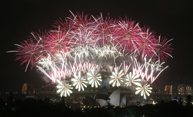 Fireworks explode over the Harbour Bridge and the Opera House during New Year's Eve celebrations in Sydney