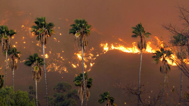 A wildfire burns in the hills just north of the San Gabriel Valley community of Glendora, Calif., Jan 16, 2014.