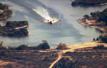 Watch: Calif. wildfire water bombers take on thousands of gallons in seconds