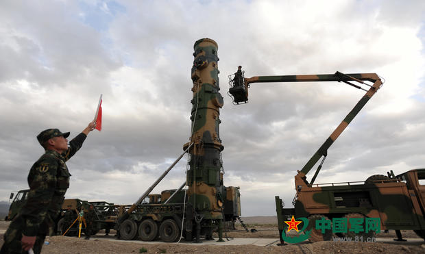 In a photo released by China's People's Liberation Army, soldiers prepare a mobile launch vehicle to test fire a Dongfeng-31 international ballistic missile