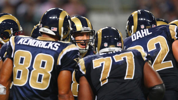 Sam Bradford, #8 of the St. Louis Rams, huddles up against the Philadelphia Eagles at the Edward Jones Dome Sept. 11, 2011, in St. Louis.