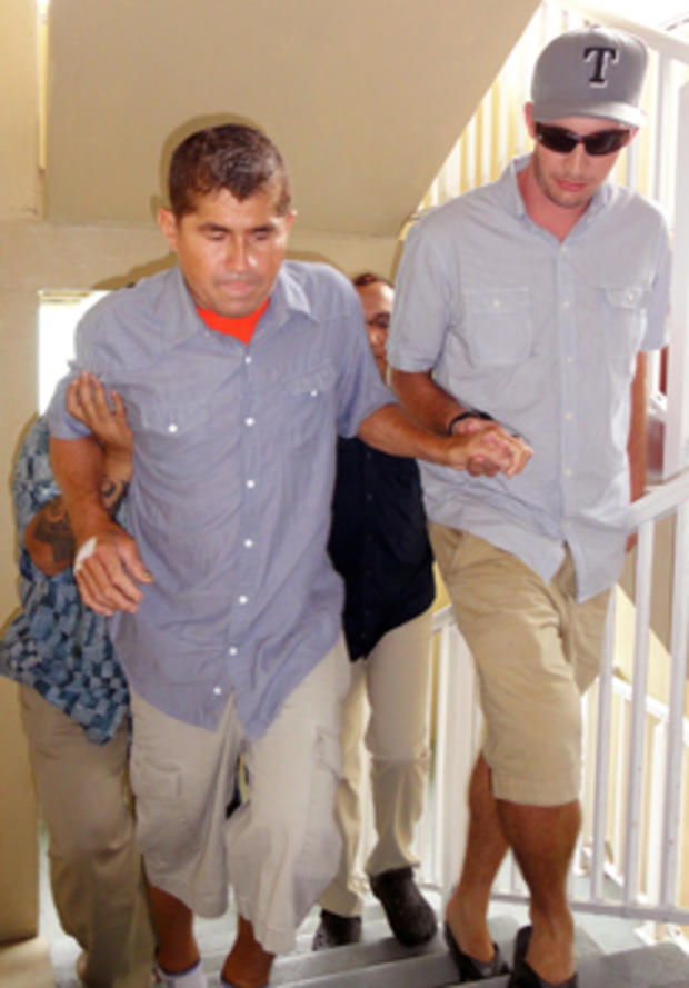Pacific castaway Jose Salvador Alvarenga (L) is helped into a press conference in the Marshall Islands