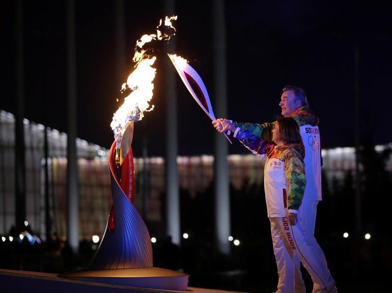 flame lighting olympics. winter olympics 2014: u.s. nabs 1st gold, choice for torch lighting questioned - cbs news flame
