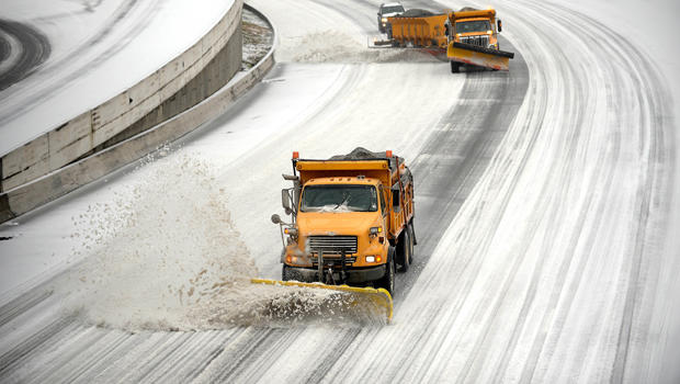 Snowplows clear downtown lanes on Interstate 75/85 during a winter storm Feb. 12, 2014, in Atlanta.