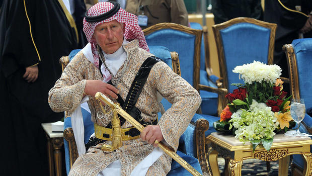 "Britain's Prince Charles, wearing a traditional Saudi attire, attends the traditional Saudi dance known as ""Arda,"" which was performed during Janadriya culture festival at Der'iya in Riyadh, Saudi Arabia, Feb. 18, 2014."