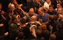 Ukrainian parliamentarians brawl during emergency session