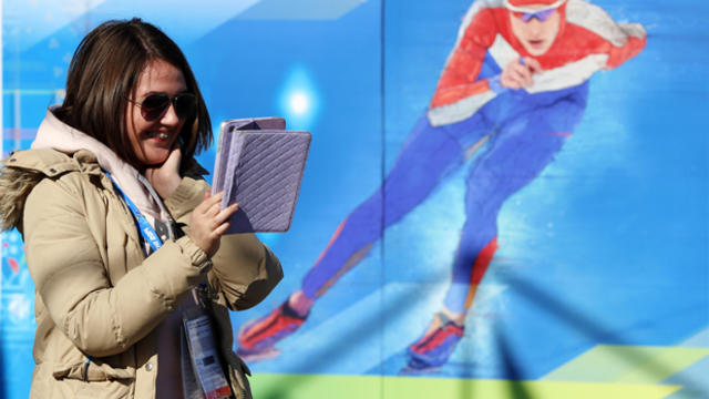 A woman speaks to somebody via a tablet computer ahead of the team welcome ceremony Feb. 6, 2014, prior to the start of the 2014 Sochi Winter Olympic Games.