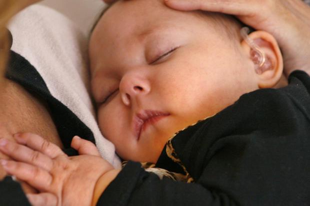Baby cuddling