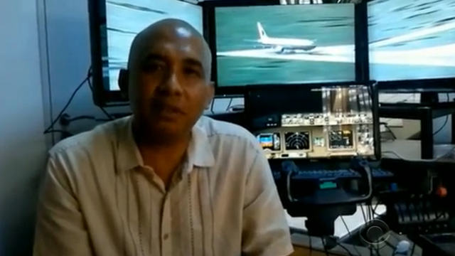 Malaysia Airlines pilot Zaharie Ahmad Shah with flight simulator