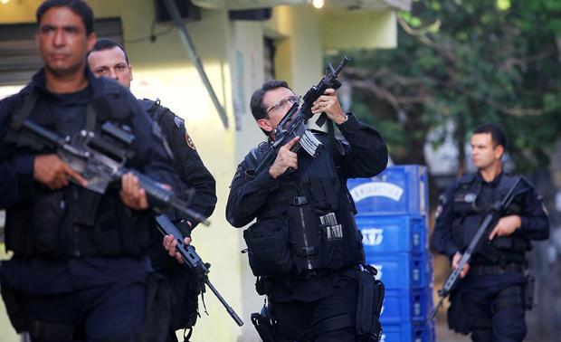 Brazilian security forces raid Rio slums ahead of World Cup