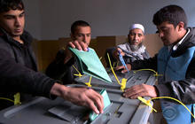 Millions turn out for Afghan election, but terror fears still loom large