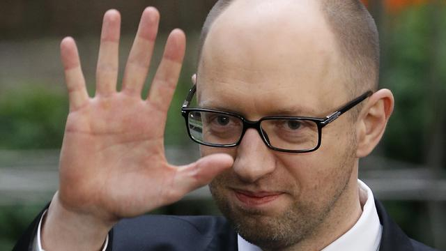 Ukraine's Prime Minister Arseniy Yatsenyuk leaves a European Union leaders summit in Brussels