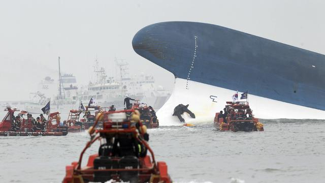 Part of the South Korean passenger ferry Sewol sticks out of the sea after sinking as maritime police search for passengers off Jindo, South Korea, April 16, 2014.