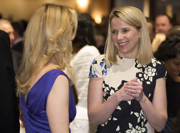 Yahoo Chief Executive Officer Marissa Meyer, right, speaks with a guest at the White House Correspondents' Association dinner in Washington May 3, 2014.