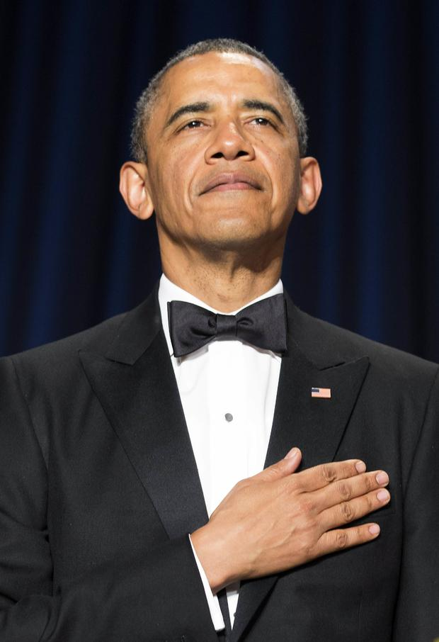 President Obama stands during the posting of colors at the White House Correspondents' Association dinner in Washington May 3, 2014.