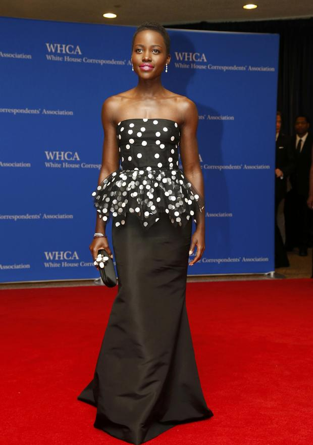 Actress Lupita Nyong'o arrives on the red carpet at the annual White House Correspondents' Association dinner in Washington May 3, 2014.