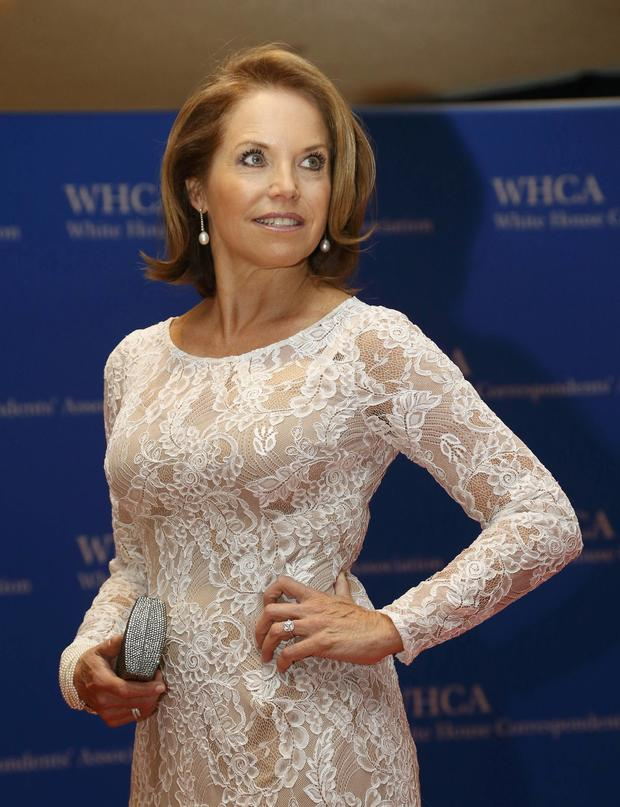 Journalist Katie Couric arrives on the red carpet at the annual White House Correspondents' Association dinner in Washington May 3, 2014.