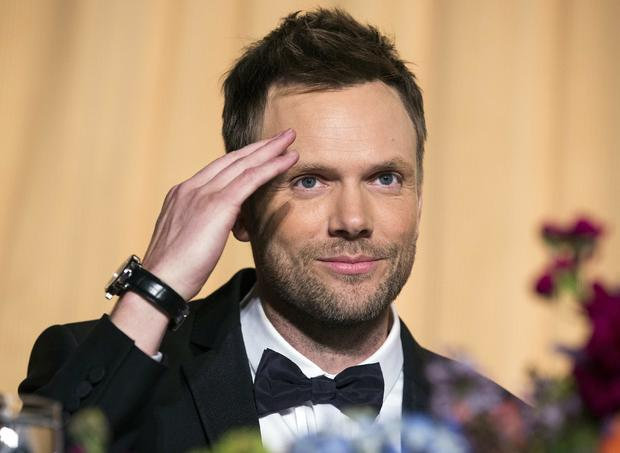 Comedian Joel McHale salutes the audience at the White House Correspondents' Association dinner in Washington May 3, 2014.
