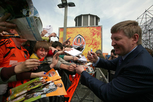 Rinat Akhmetov signs autograph after unveiling his star on the newly opened FC Shakhtar Walk of Fame in Donetsk