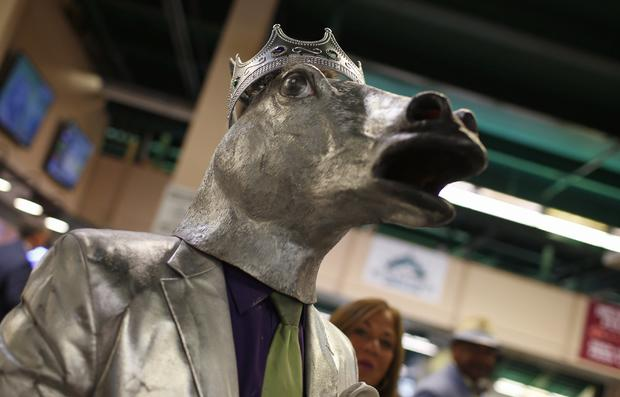 Mike Calimano is pictured wearing a California Chrome outfit in the stadium before the 146th running of the Belmont Stakes in Elmont, New York, June 7, 2014.