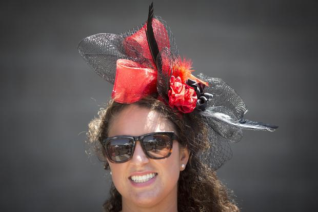 Victoria Garofalo poses for a portrait with her colorful hat before the 146th running of the 2014 Belmont Stakes in Elmont, New York, June 7, 2014.
