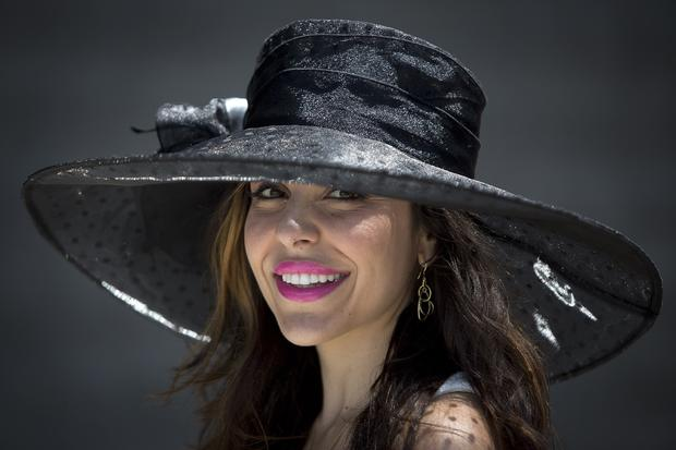 Kellee Khalil poses for a portrait with her hat before the 146th running of the 2014 Belmont Stakes in Elmont, New York, June 7, 2014.