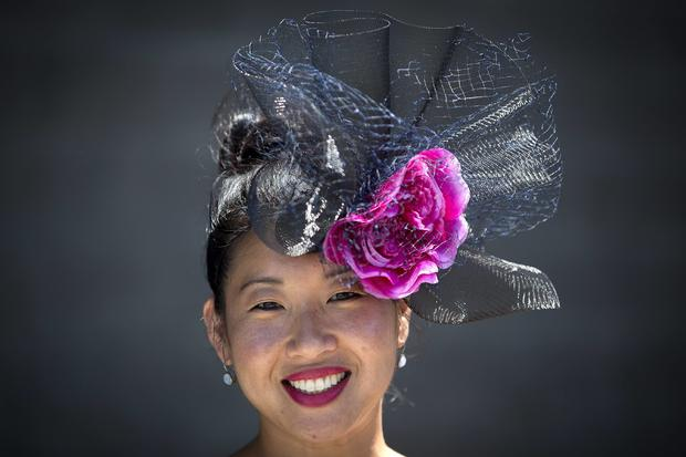 Anne Heffernan poses for a portrait with her colorful hat before the 146th running of the 2014 Belmont Stakes in Elmont, New York, June 7, 2014.