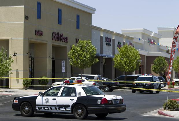 Metro Police patrol cars are used to block off access to CiCi's Pizza after a shooting in Las Vegas