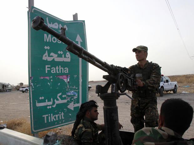 Members of the Kurdish security forces take part in an intensive security deployment on the outskirts of Kirkuk, Iraq, June 12, 2014.