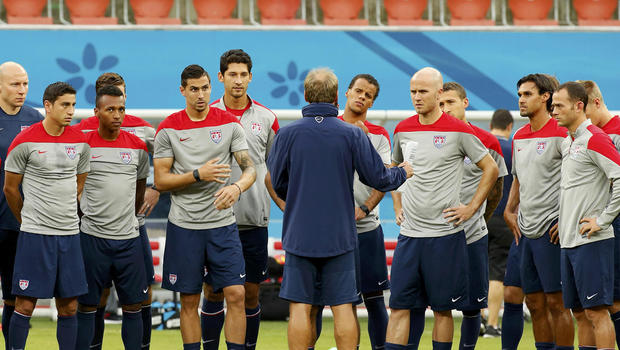USA national soccer team head coach Jurgen Klinsmann, center, speaks to his players ahead of their training session in Manaus, Brazil, June 21, 2014. Portugal will play the USA June 22.