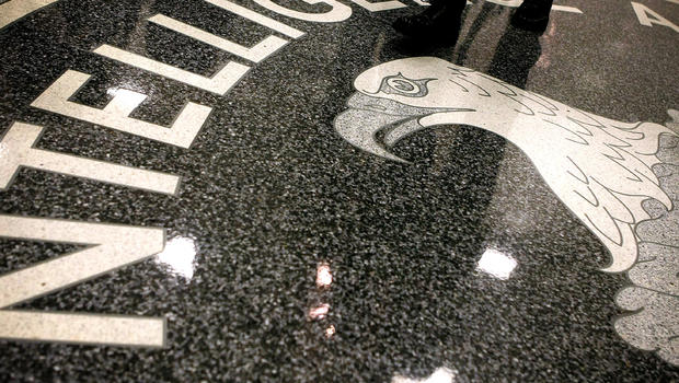 A man walks across the seal of the Central Intelligence Agency in the lobby of CIA headquarters in McLean Virginia.                        Alex Wong Getty Images