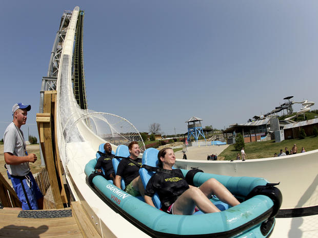 "Riders go down the world's tallest waterslide, called ""Verruckt,"" at Schlitterbahn Waterpark July 9, 2014, in Kansas City, Kan., in this picture taken with a fisheye lens."
