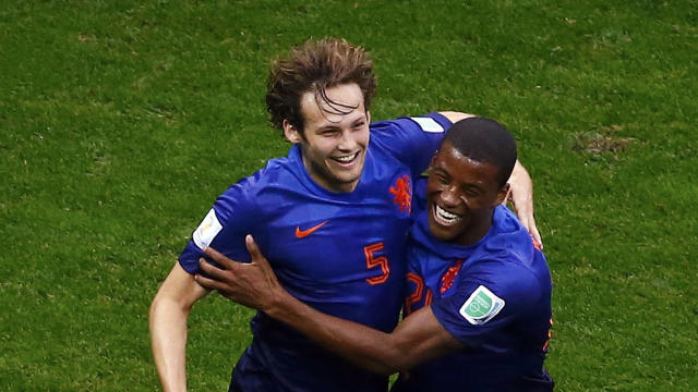 Daley Blind of the Netherlands celebrates his goal against Brazil with teammate Georginio Wijnaldum during their 2014 World Cup third-place playoff at the Brasilia national stadium in Brasilia July 12, 2014.