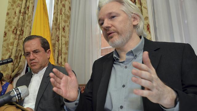 WikiLeaks founder Julian Assange speaks as Ecuador's Foreign Affairs Minister Ricardo Patino listens