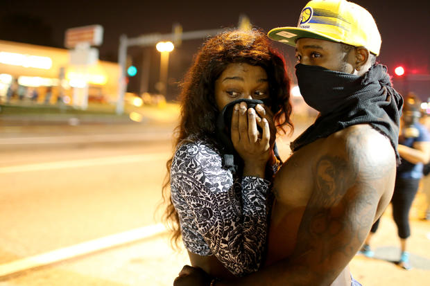 Tensions flare in Ferguson, Mo., over police shooting