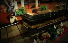 Emotions run high as Michael Brown is laid to rest