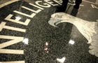 A man walks across the seal of the Central Intelligence Agency at the lobby of the Original Headquarters Building at the CIA headquarters Feb. 19, 2009, in McLean, Virginia.