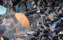 Pro-democracy protestors in Hong Kong defy calls to disperse