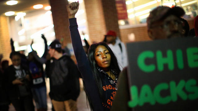 Demonstrators face off with police in a Walgreen's parking lot as protests continue in the wake of 18-year-old Michael Brown's death Oct. 22, 2014, in Ferguson, Missouri.