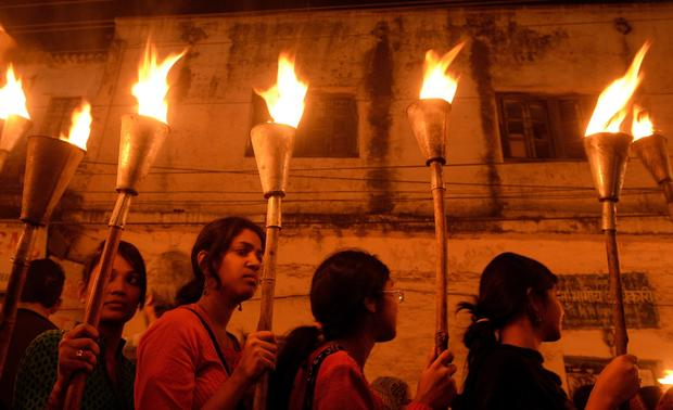Indian victims of the Bhopal gas disaster take part in a torch-lit procession to mark its 30th anniversary in Bhopal Dec. 2, 2014.