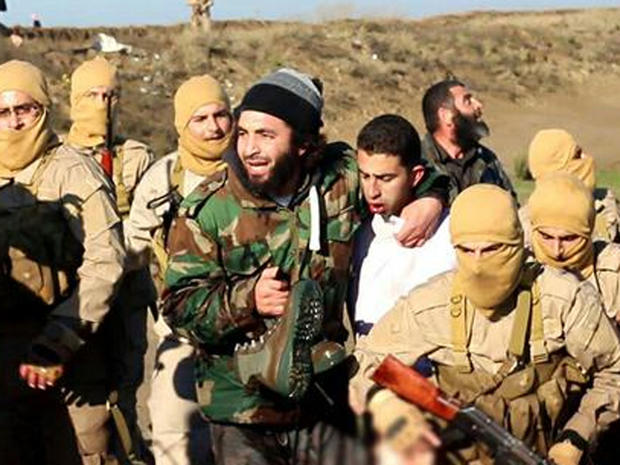 Image from ISIS branch in Raqqa, Syria, purports to show coalition pilot captured after, activist groups say, a warplane was shot down over Syria by ISIS on December 24, 2014; CBS News could not verify the authenticity of the image