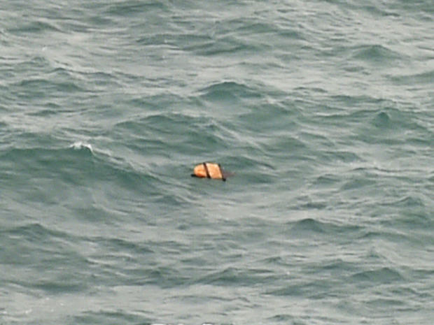 Aerial view taken from Indonesian search and rescue aircraft over Java Sea shows floating debris spotted in same area as other items being investigated by Indonesian authorities as possible objects from missing AirAsia Flight 8501 on December 30, 2014