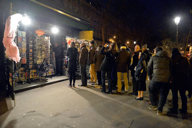 Customers wait in line at Pigalle newstand, where the new edition of Charlie Hebdo magazine was on sale