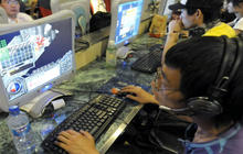 China tightens grip on Internet access