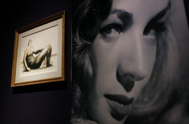 A photograph of Lauren Bacall sits beside a Henry Moore lithograph at Bonhams auctioneers in London, England, Feb. 13, 2015.