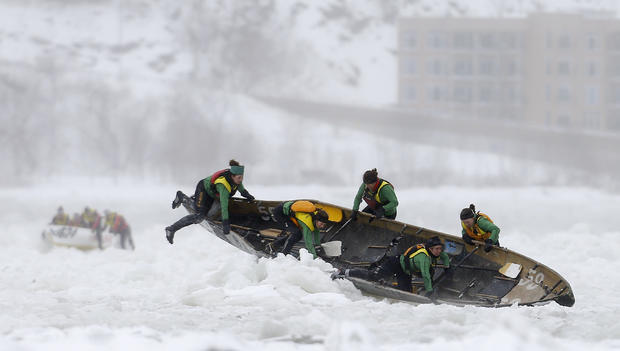 Team Bota Bota competes during the Quebec Winter Carnival ice canoe race on the St. Lawrence River in Quebec City, Canada, Feb. 8, 2015.