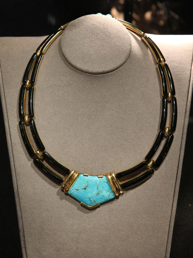 A turquoise enamel and 18-karat gold necklace belonging to Lauren Bacall are displayed at Bonhams auctioneers in London, England, Feb. 13, 2015.
