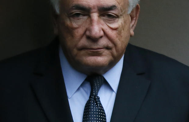 Former IMF head Dominique Strauss-Kahn leaves his hotel to attend the trial in the so-called Carlton Affair, in Lille, France, Feb. 11, 2015, where 14 people, including Strauss-Kahn, stand accused of sex offenses, including the alleged procuring of prosti